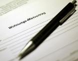 Kugelschreiber auf Mietvertrag für Wohnung