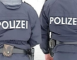 Zwei Polizisten von hinten