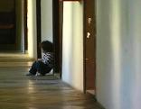 Kind in einem Quartier für Asylwerber