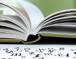 Buch mit Buchstabensalat