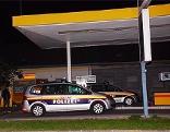 Polizei bei überfallener Tankstelle