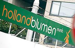 Schild einer Hollandblumen Mark Filiale