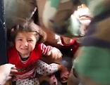 Verzweifeltes Kind im Krieg