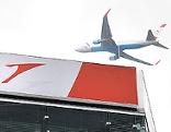 """Schrift """"Austrian"""" mit Flugzeug"""
