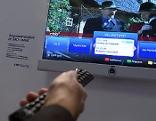 Fernbedienung und Computerbildschirm