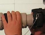 Mann mit Kamera und Teleobjektiv (Detektiv/Paparazzi)