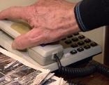 Hand auf Telefon