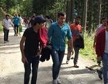Wanderung mit Flüchtlingen Asylwerber