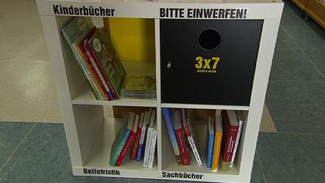 Aufforderung zum Mitvoten für Buchpreis in einer Buchhandlung