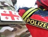 Enblem der österreichischen Polizei mit georgischem Wappen