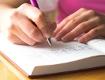 offenes Tagebuch mit Kugelschreiber
