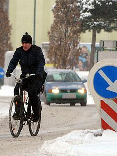 Radfahrer im Schneetreiben