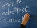 Teilnehmer eines Deutschkurses