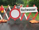 Schild Hochwasser Straße Überschwemmung