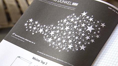 """Schulhefte mit """"Licht ins Dunkel""""-Logo"""