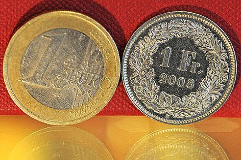 Euro und Franken-Münze