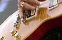 E Gitarre (E-Gitarre) wird gespielt