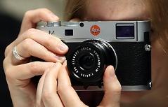 Fotografin mit Fotoapparat
