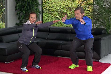 Doresia Krings und Michael Mayerhofer bei Kniebeuge