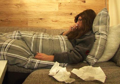 Kranke Frau im Bett