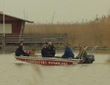 Boot mit Hund am See