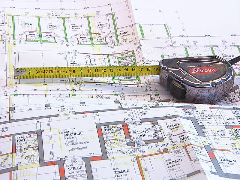 Massband auf Immobilienplan