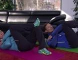 Doresia Krings und Michael Mayrhofer bei der Bauchübung