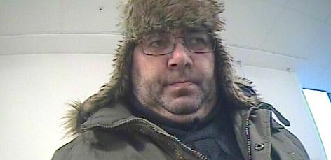 Foto des Täters bei der Bankomatabhebung