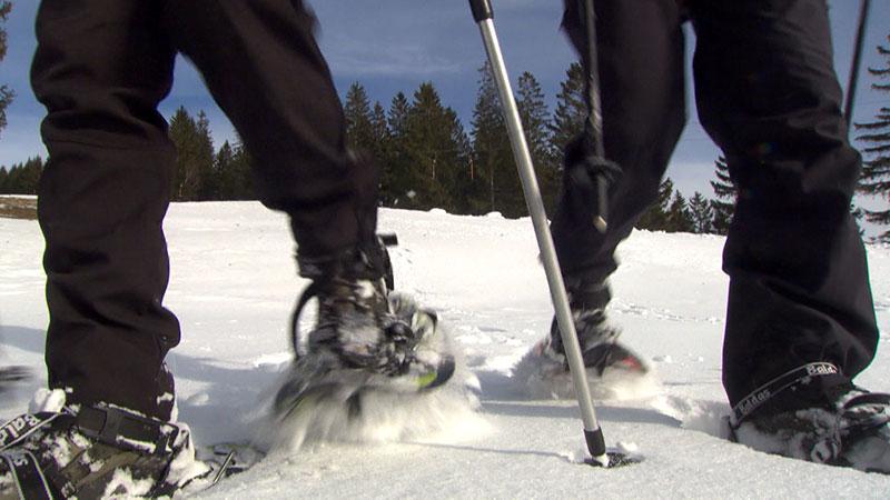 Schneeschuhwanderer Füße